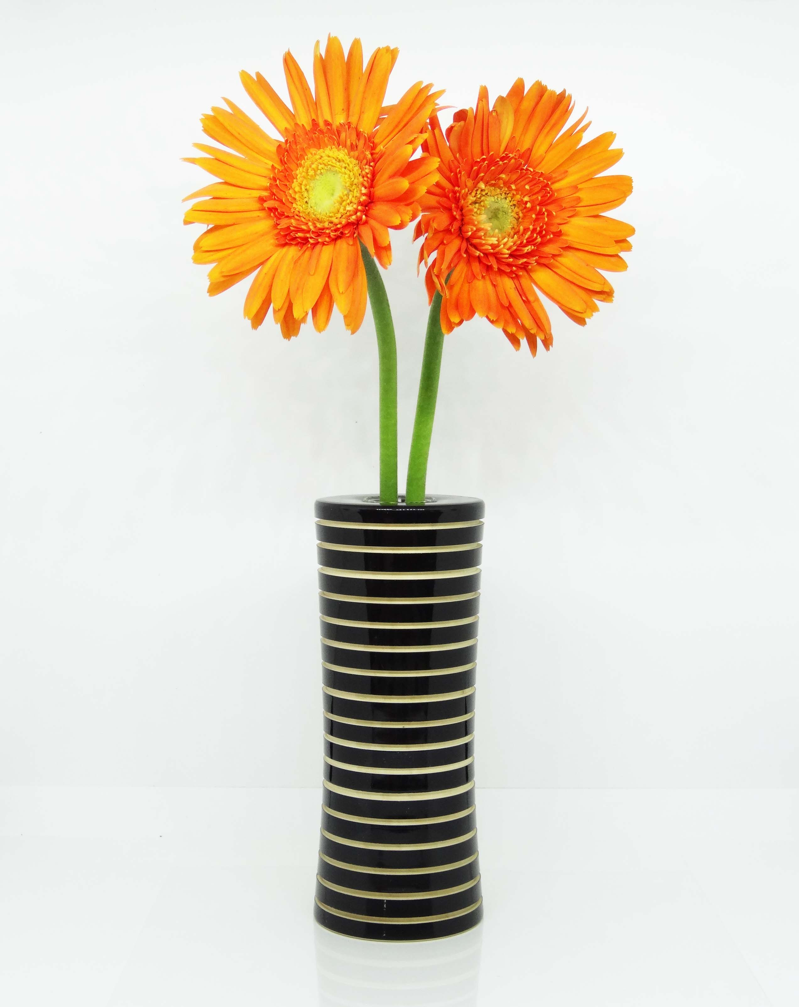 Show pictures of flowers in vase